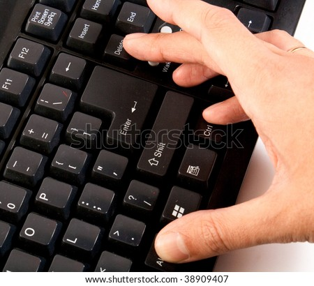 hand pressing ctrl alt delete on black keyboard - stock photo