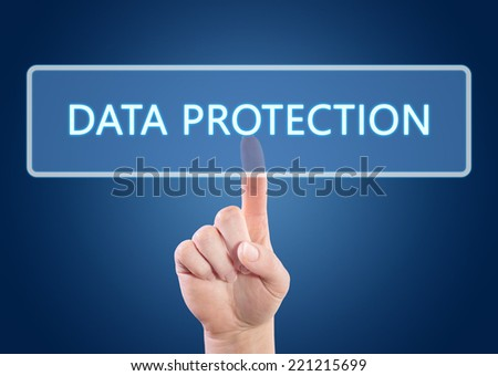 Hand pressing Data Protection button on interface with blue background. - stock photo