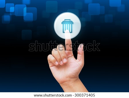 Hand pressing Delete  button with technology background  - stock photo