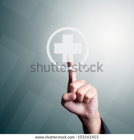 Hand pressing first aid sign - stock photo