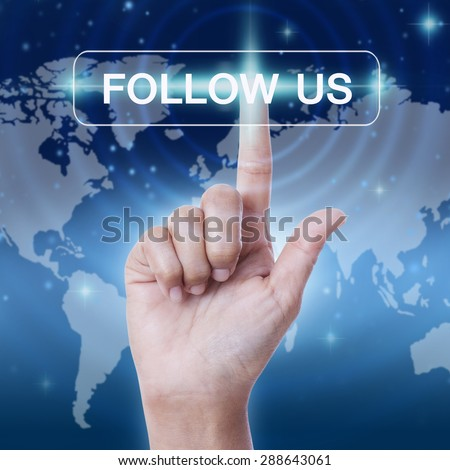 hand pressing follow us word button on virtual screen. business concept - stock photo
