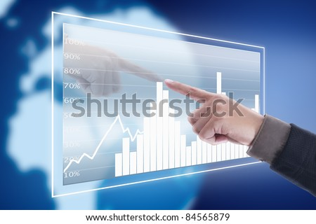 Hand pressing graph screen with blue world background