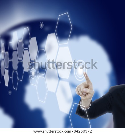 Hand pressing hexagon touch screen in space with blue world background - stock photo