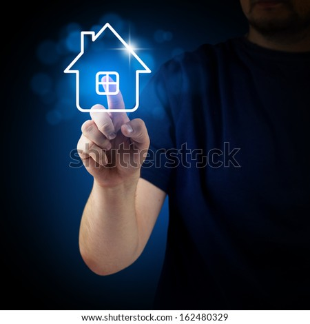 Hand pressing house icon on the virtual background - stock photo