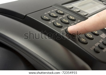 hand pressing key on black phone - stock photo