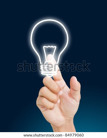 Hand pressing light bulb - stock photo