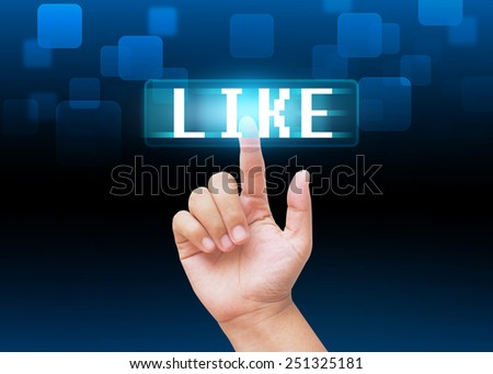 Hand pressing like buttons with technology background  - stock photo