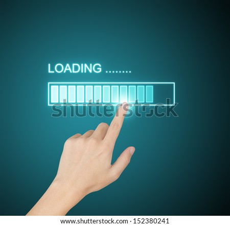 hand pressing loading progress on screen - stock photo