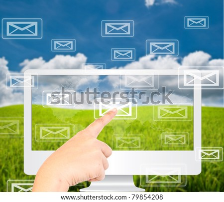 Hand pressing many mail on monitor on the blue sky nature. - stock photo