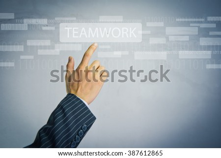 Hand pressing modern multimedia teamwork type buttons on network concept structure,Businessman