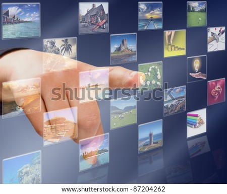 Hand pressing modern touch screen buttons with heart symbol - stock photo