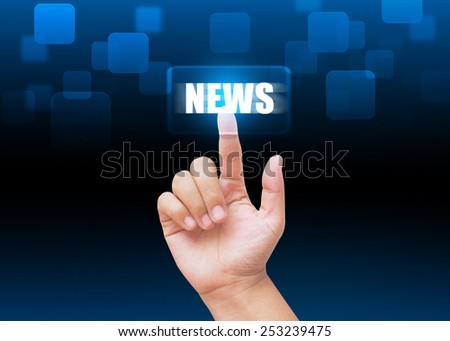 Hand pressing NEWS buttons with technology background