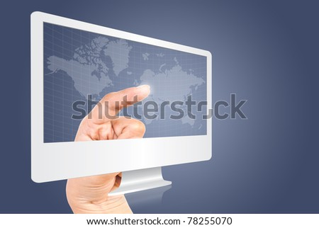 hand pressing point down of the plan world wide in monitor.