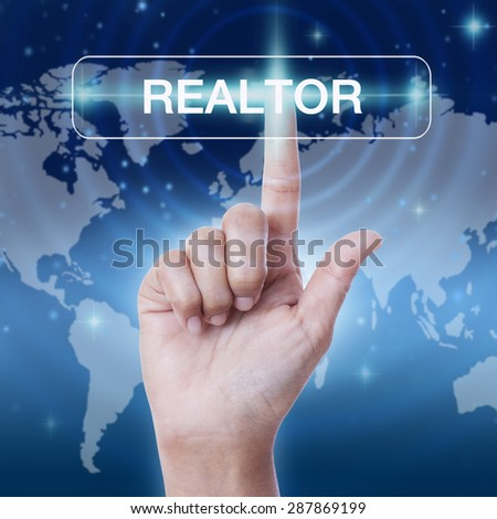 hand pressing realtor word button on virtual screen. business concept - stock photo