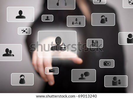 hand pressing social media button - stock photo