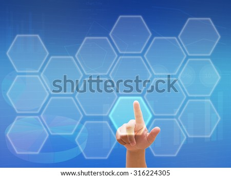 hand pressing social media button - business goal on touch screen  - stock photo