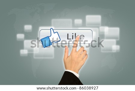 Hand pressing Social Network Like icon - stock photo