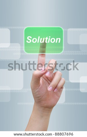 hand pressing solution button on a touch screen interface - stock photo