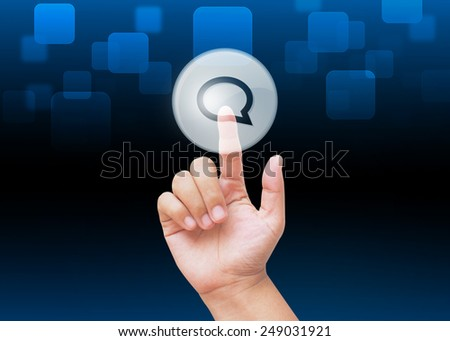 Hand pressing speech bubble buttons with technology background  - stock photo