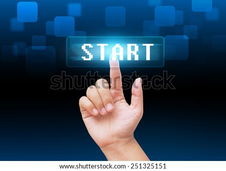 Hand pressing start buttons with technology background  - stock photo