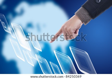Hand pressing touch screen in space with blue world background - stock photo