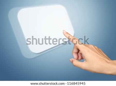 Hand pressing virtual button on blue background