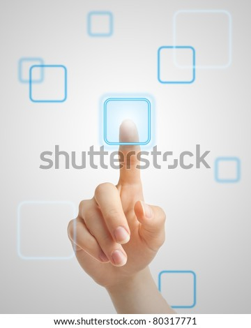 Hand pressing virtual button on futuristic holographic screen. - stock photo