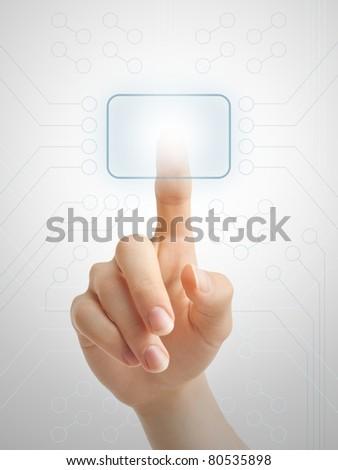 Hand pressing virtual button on futuristic holographic screen. - stock photo