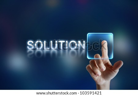 Hand pressing virtual solution button - stock photo