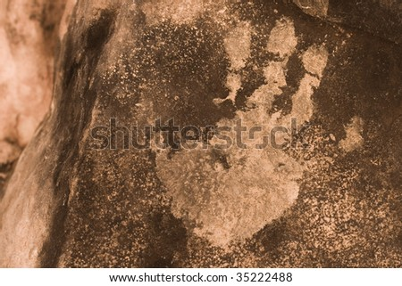 Hand print on cave wall in Kaibab National Forest, Arizona, USA. - stock photo