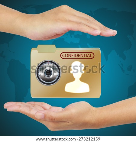 Hand protect envelope with top secret confidential file. - stock photo
