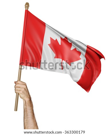 Hand proudly waving the national flag of Canada - stock photo