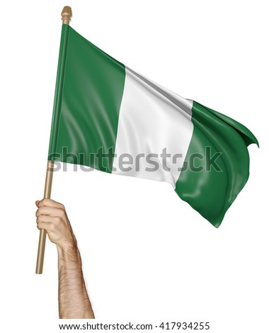 Hand proudly waving the national flag of Nigeria, 3D rendering - stock photo