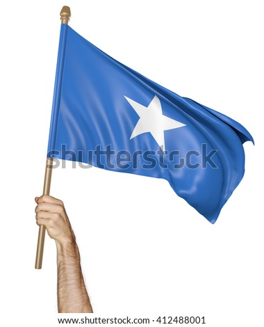 Hand proudly waving the national flag of Somalia, 3D rendering - stock photo