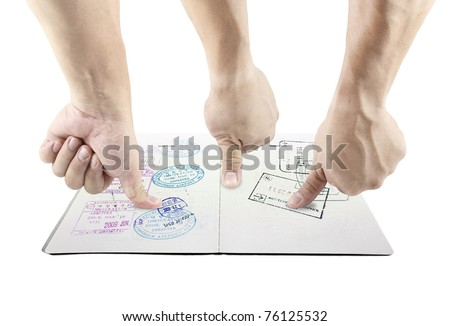 Hand providing thumbprint on a passport visa page for biometric identification which is isolated against white background. - stock photo