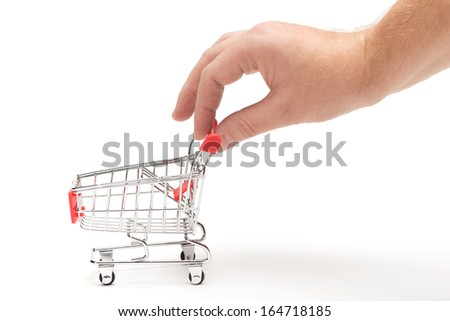 Hand pulling a shopping cart, isolated on white background