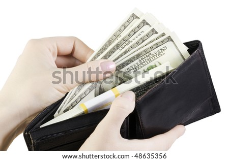 hand pulling dollars out of the wallet - stock photo