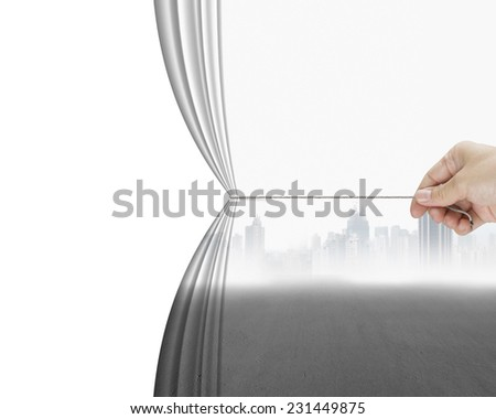 hand pulling gray cityscape curtain revealing empty blank space, isolated on white background - stock photo