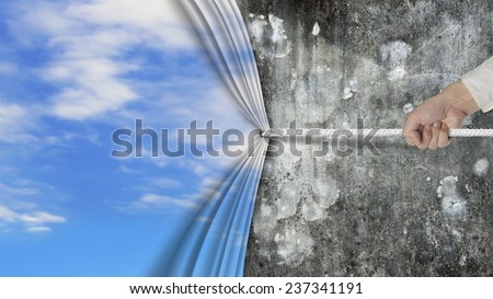 hand pulling natural sky curtain covered old dirty mottled concrete wall isolated on white background - stock photo
