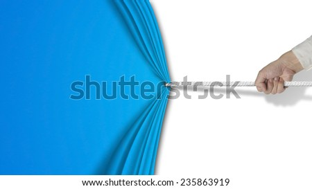 hand pulling open blue curtain with blank behind isolated on white background - stock photo