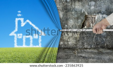 hand pulling open shape cloud curtain covered old broken wall ruins background - stock photo
