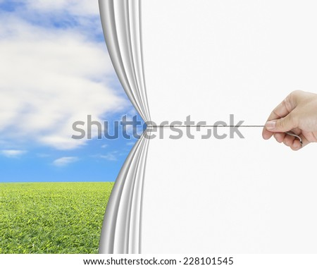 hand pulling open white blank curtain discovered natural sky meadow - stock photo