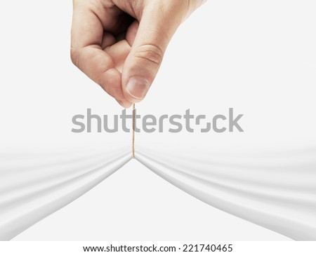 hand pulling rope on a white background - stock photo