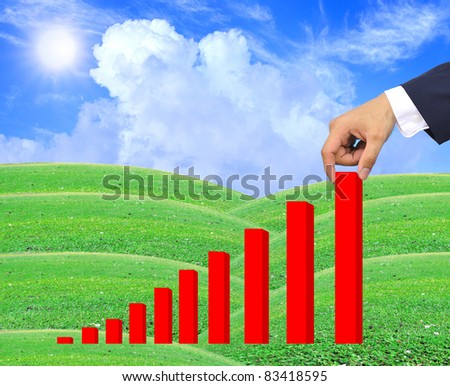 hand pulling up a bar from a graph - stock photo