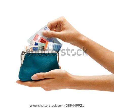 Hand pulls out of purse euro banknotes. Business concept - stock photo