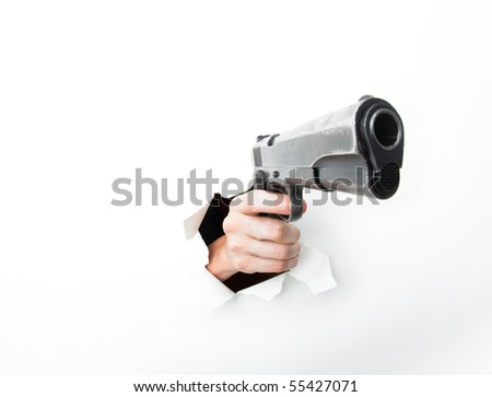 Hand punching through white paper with big semiautomatic pistol. Photographed with a fisheye lens for exaggerated perspective. - stock photo