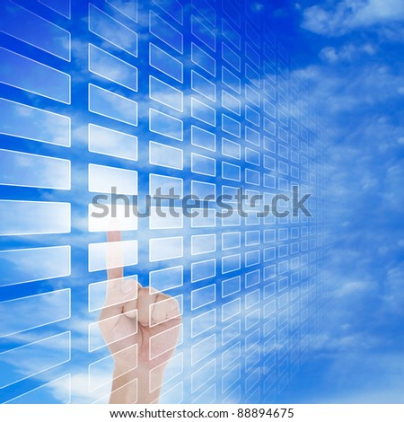 hand push a touch screen button with blue  sky background - stock photo