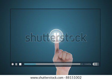 hand push pause button on touch screen to suspend video clip - stock photo