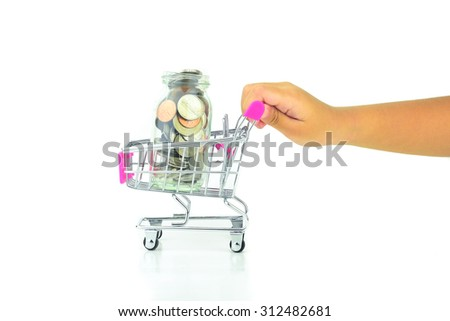 Hand push shopping cart with coin in glass jar - stock photo