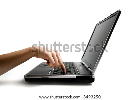 Hand push the ENTER button on a black laptop on white background